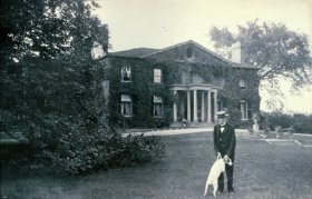 Mr. Smith standing outside of the Grange House