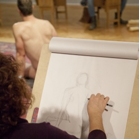 Woman drawing man