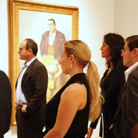 Corporate members looking at art