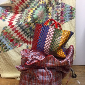 hand made tote bags with quilt in background