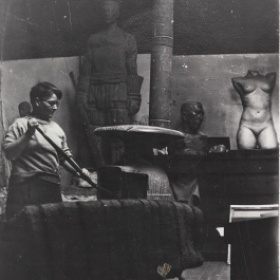 Florence Wyle working in her studio