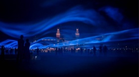 image of Waterlight installation with beams of light mimicking waves of water