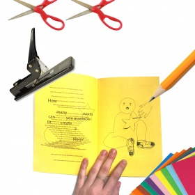 zine with scissors and stapler