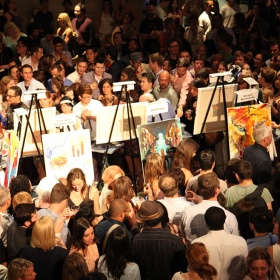 easels set up in a crowd of people