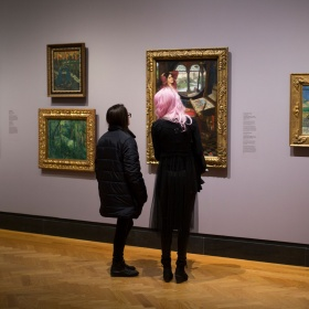 Visitors in the gallery looking at art