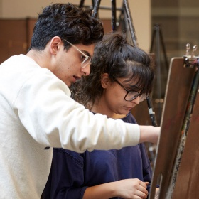 Two people at an easel