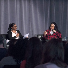 Angie Thomas with Donna Bailey Nurse, in front of an audience