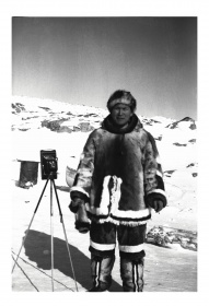 Photo of Peter Pitseolak with his 122 camera