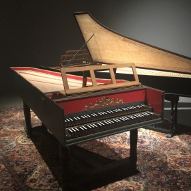 image of two harpsichord instruments on a persian carpet