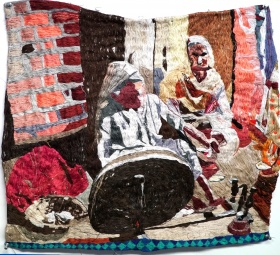 Textile work by Jagdeep Raina depicting two figures in tones of brown, pink, brick red, beige and pale yellow