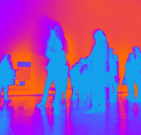 A group of figures blurred against a red, orange and purple haze.