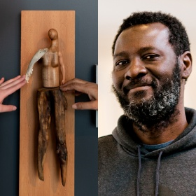 "Image split into two: On the left a photo of two hands outside the frame reaching to touch a sculpture by Persimmon Blackbridge. The piece is titled ""Soft Touch"", and is a handcrafted figure made of wood, bone and plastic to resemble a person constructed from found objects. It is mounted on a wood panel. On the left photograph head shot of figure looking and smiling at camera"