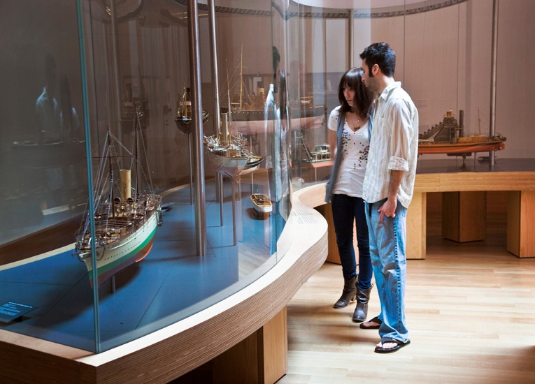 Couple looking at objects in the Thomson Collection of Ship Models
