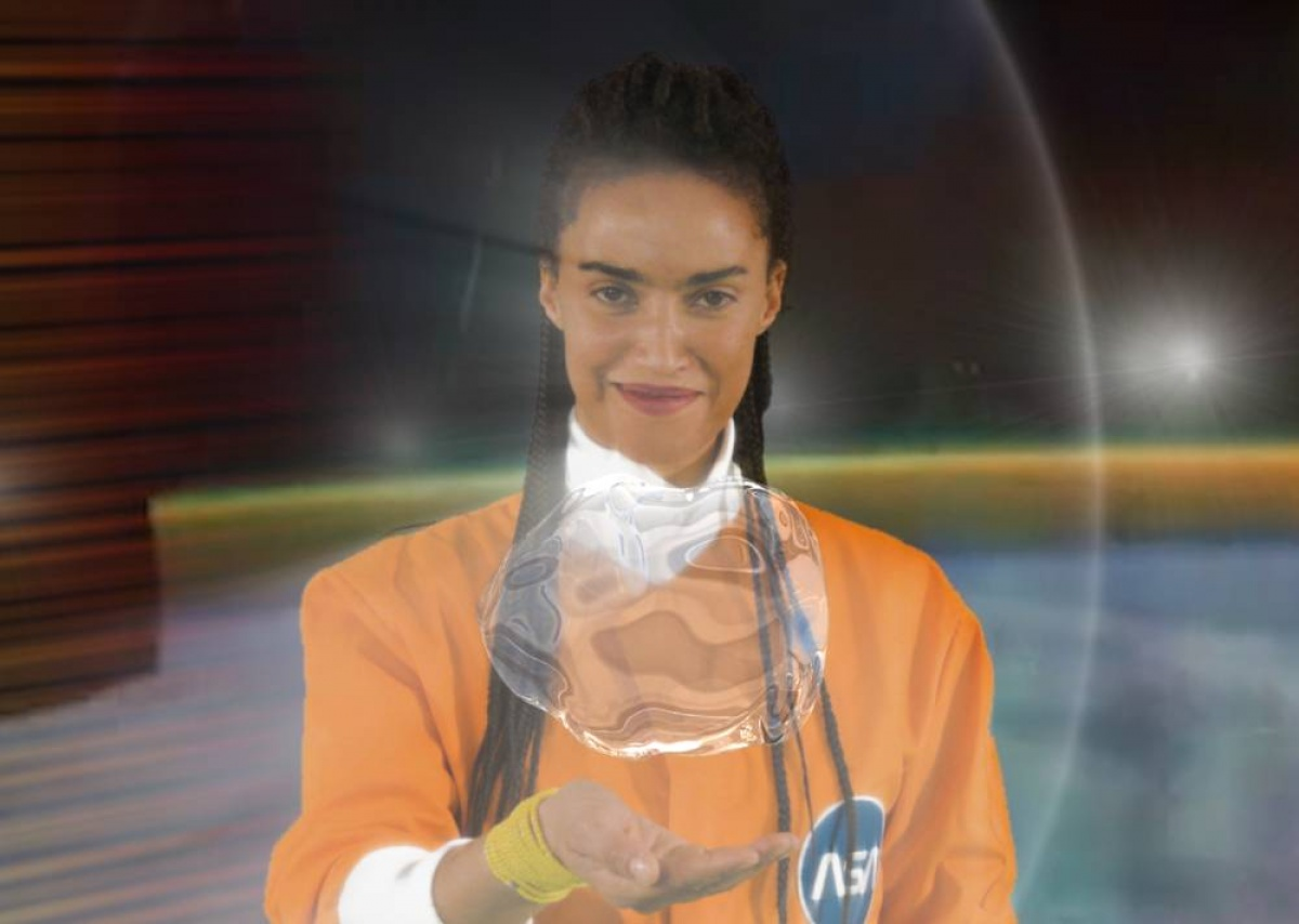 Woman with bubble of water hovering above her open hand.