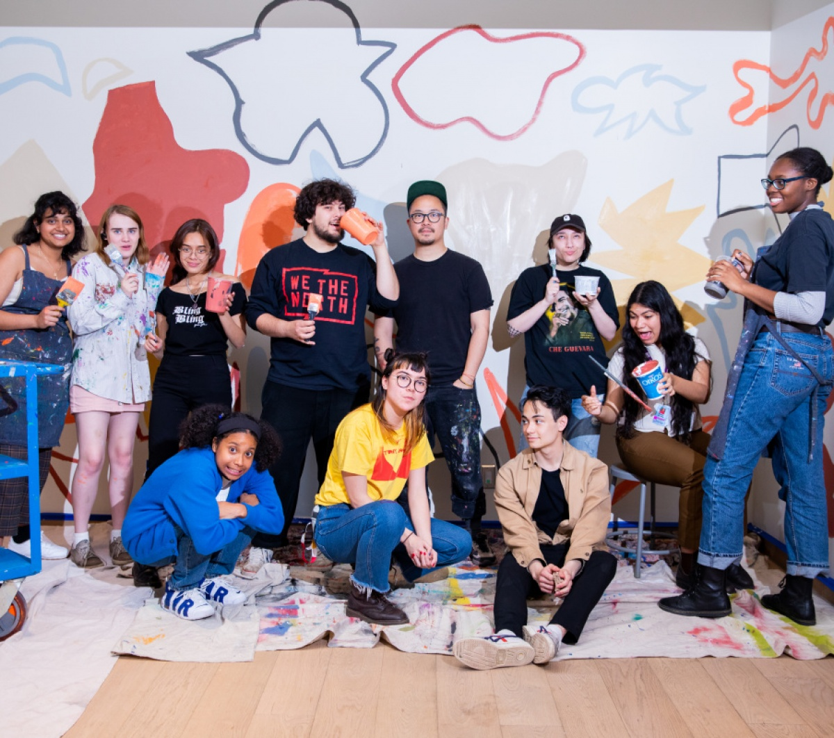 Group of AGO Youth posing with art work