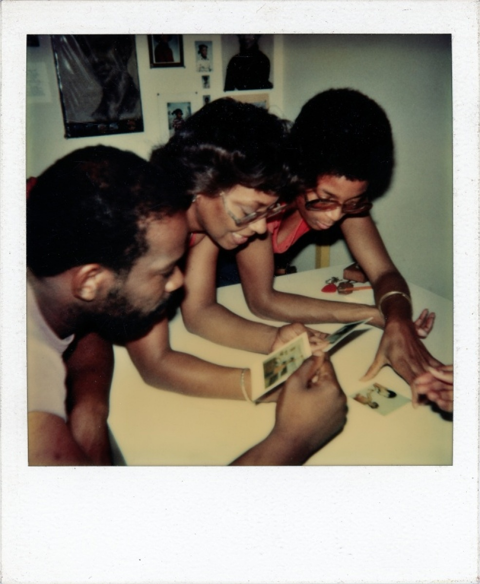 Unknown photographer, [Looking at Polaroids]