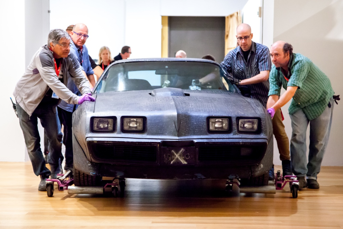 AGO staff members carefully move the Trans AM
