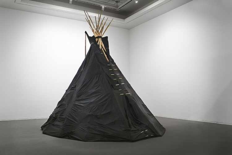 Large Teepee made out of skinned leather couches.