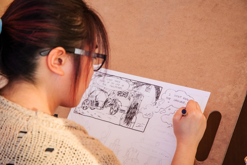 Student drawing a comic