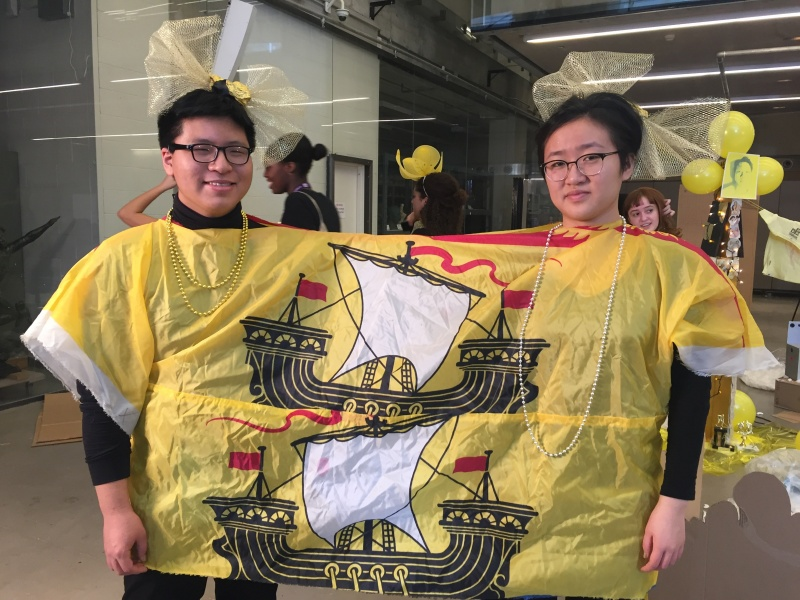 two youth wearing a hand-made sailship costume