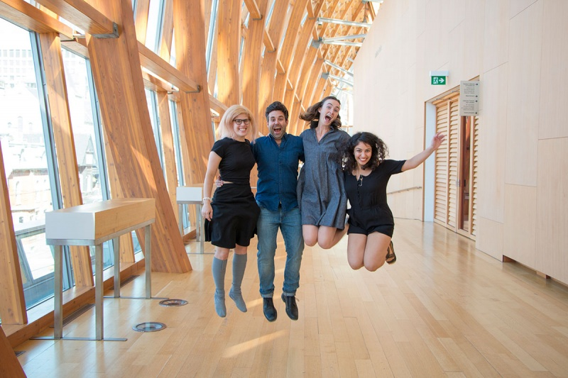 four actors jumping in mid air in Galleria Italia