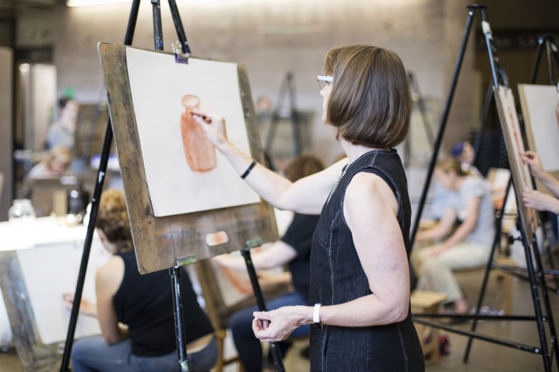 Woman drawing at an easel