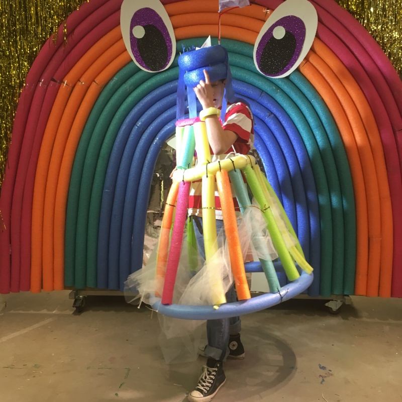 person dressed in costume made of colourful foam tubes and tulle