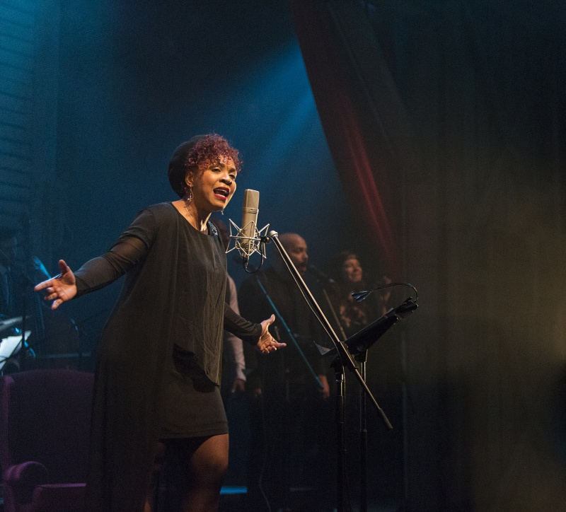 image of Soulpepper performer singing in front of an old-style microphone