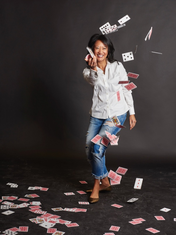 Julie Eng happily tossing a deck of playing cards