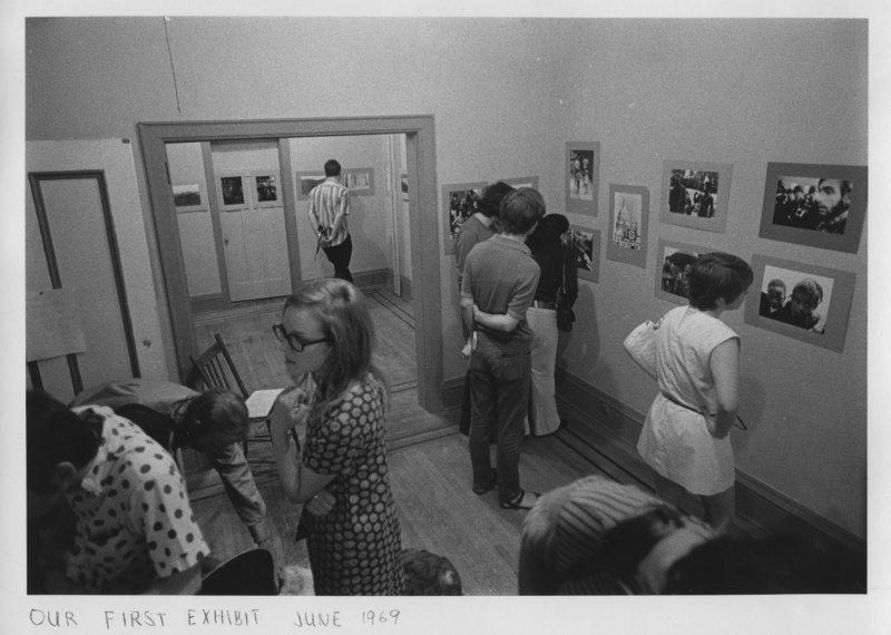 black and white image of people in an exhibition of photographs at Balwin St. Gallery in 1969