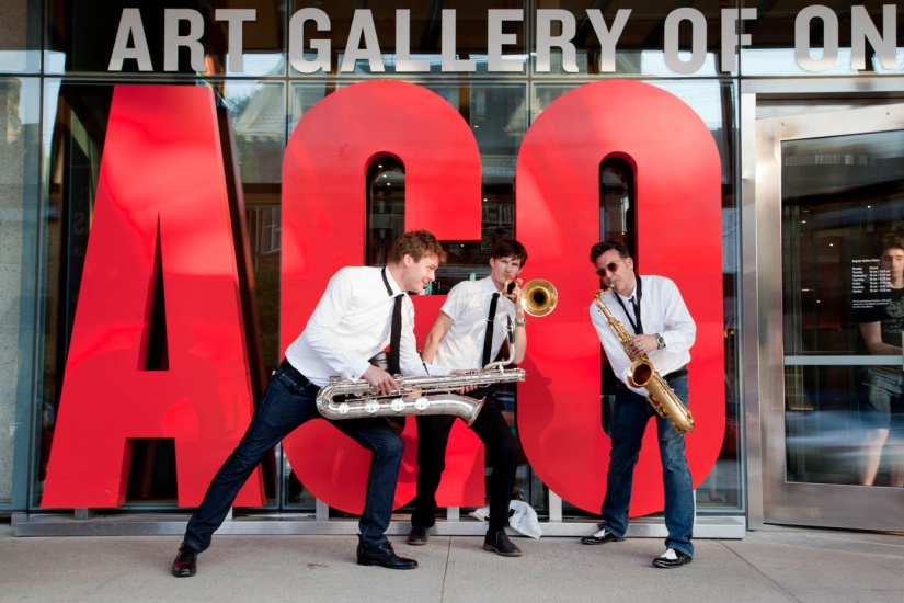 Jazz players in front of red AGO letters at main entrance