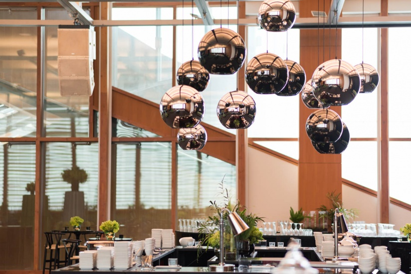 mirrored balls hanging over bar in Baille Court
