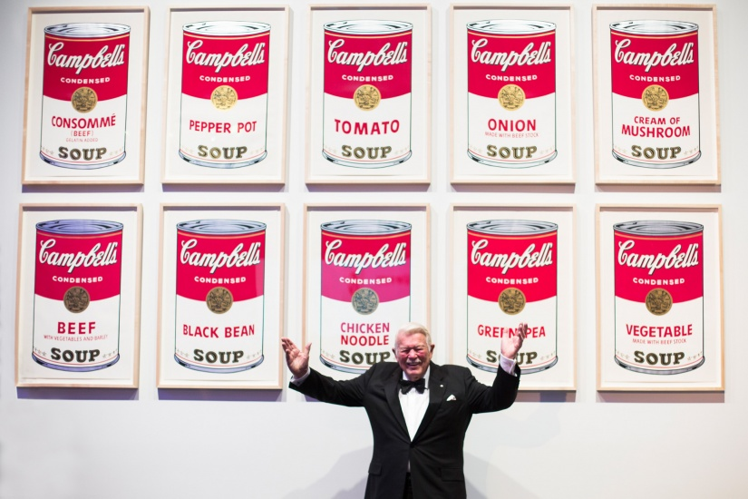 jim fleck with donated warhol soup can prints