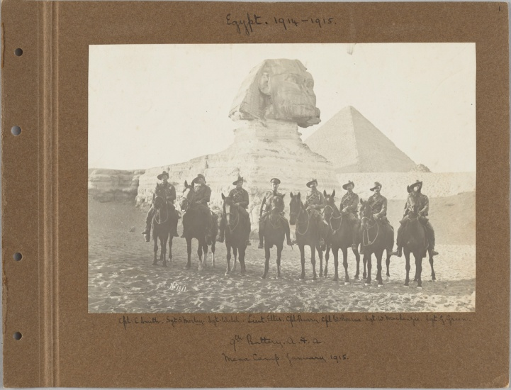 soliders on horses in front of the sphinx