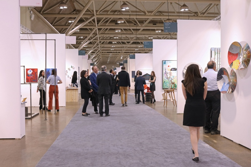 a hallway of booths at art toronto 2018