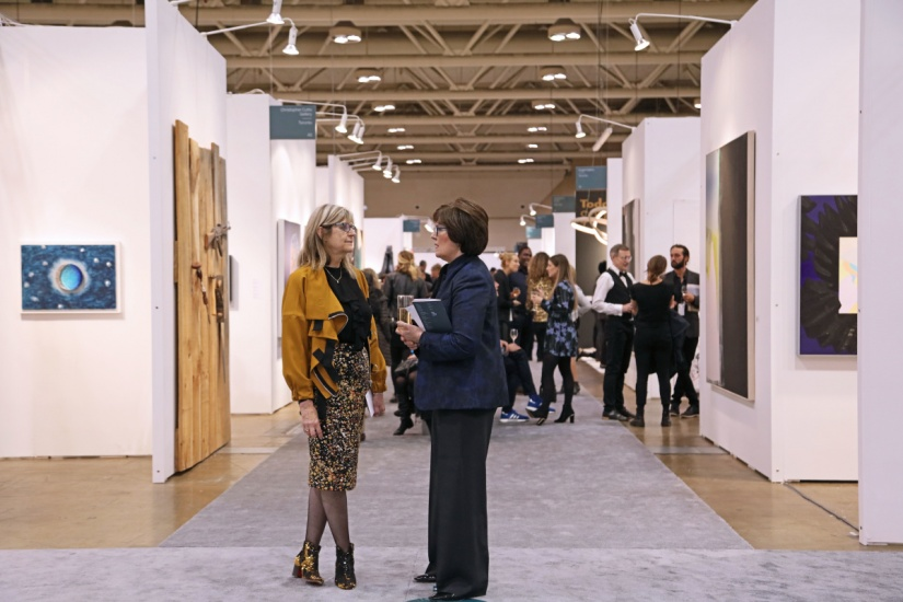people chatting at art toronto
