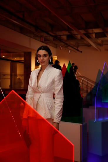 Woman posed in front of acrylic sculpture