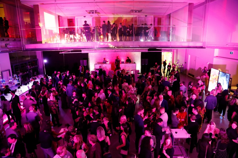 Scene of party on dance floor in pink room