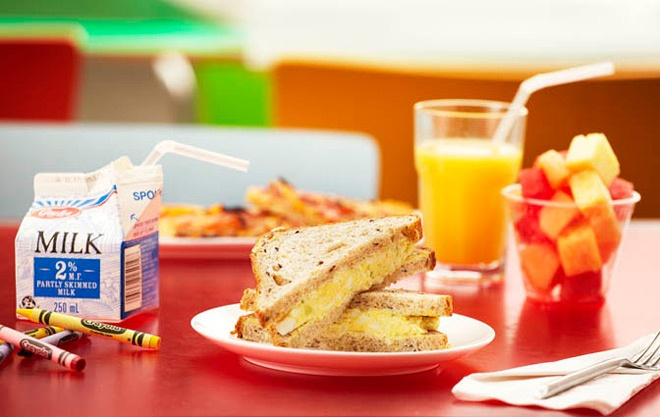 Selection of items from the café - egg salad sandwich, fruit cup, milk, juice